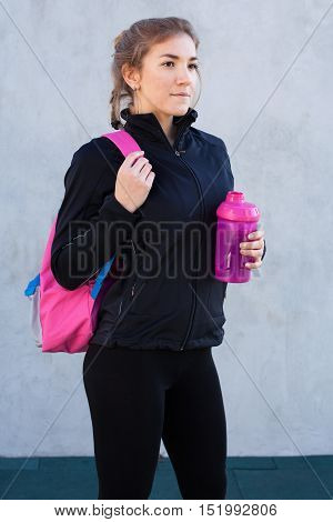 Woman athlete holding a shaker in hand