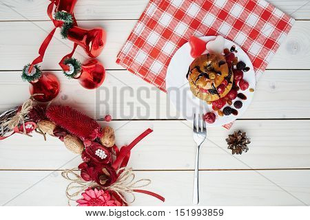 Baked apple with berries and chocolate sauce. Wooden background. Healthy lifestyle.Diet and weight loss concept. Low calories dinner. Vitamin B. Healthy food. Top view