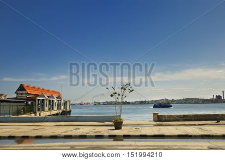 VIew of old havana harbour with pier to board boat transportation