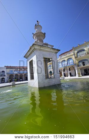 View of green water in Old Havana plaza vieja fountain, Cuba