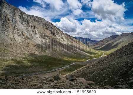 Mountain path in the beautiful valley in Tibet, on a trekking route around sacred Mount Kailash