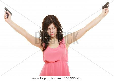 Full length sexy detective spy. Woman brunette holding gun isolated on white background