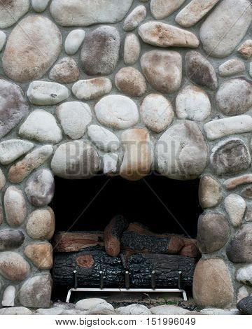 Fireplace built in the natural carved stone wall