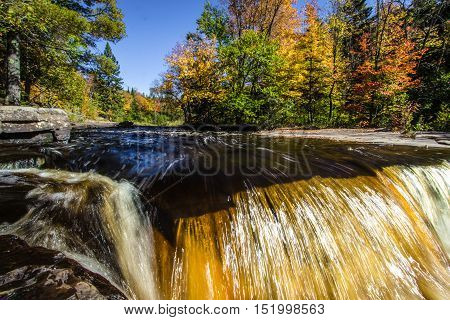 Michigan Autumn Waterfall. Waterfall in the Canyon Falls Scenic on M 28 between Marquette and Baraga.