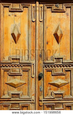 Weathered Carved Wooden Door with Inlay of Wood