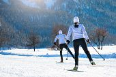 Couple Man And Woman Cross-country Skiers With Skating Technique poster