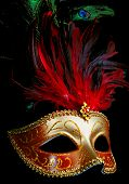 pic of fancy-dress  - pretty gold ornate mask with red feathers on black background  - JPG
