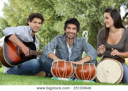 Three young musicians in park