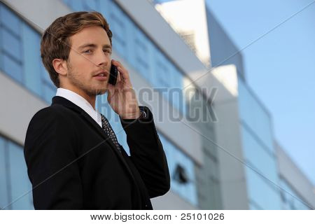 Male executive using a cellphone