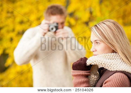 Autumn Man Make Photo Of Young Woman