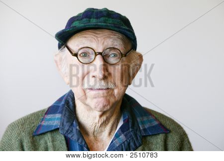 Senior Man In Glasses And A Sweater