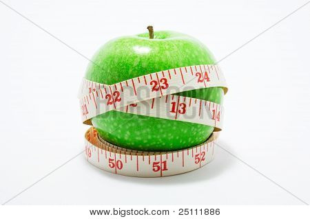Measurement Tape Wrapped Around Green Apple