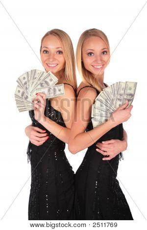 Doppelmädchen mit US-Dollar