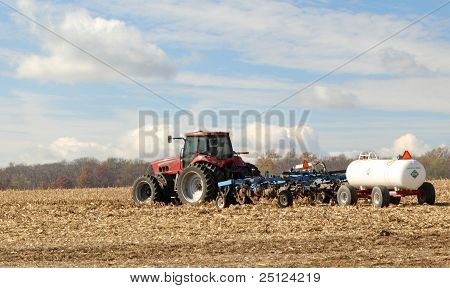 Plowing And Fertilizing Farm Field