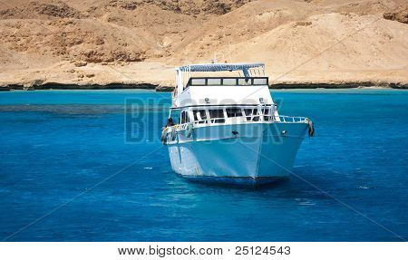 Boat is floating in a beautiful water