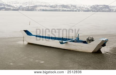 Old Traditional Boat On A Frozen Lake