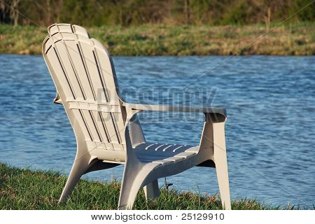 Chair at the water's edge