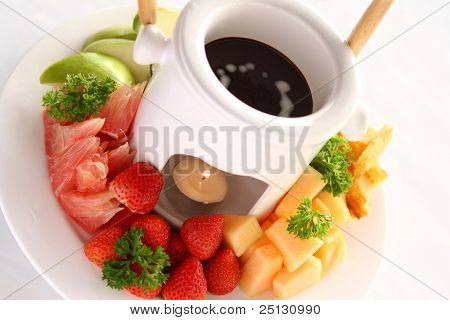 A deluxe Chocolate fondue served with variety fruits