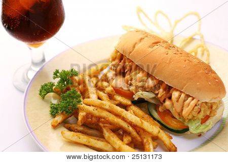 fast food crispy chicken sandwich served with crispy french fries and soda