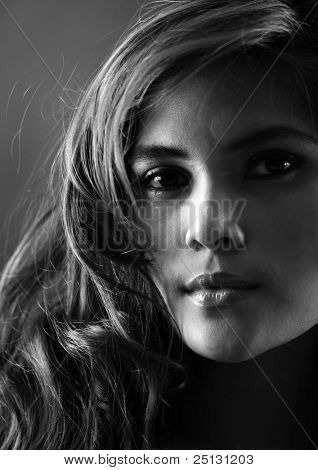 Stunning portrait of a young woman in black and white