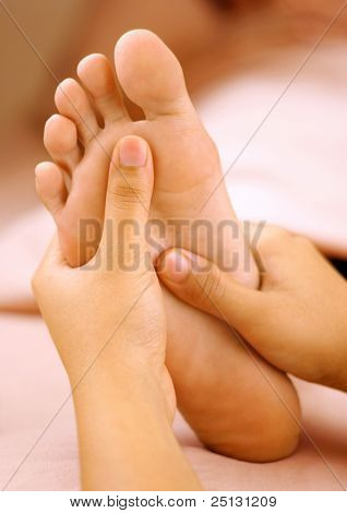 reflexology foot massage, spa foot treatment.