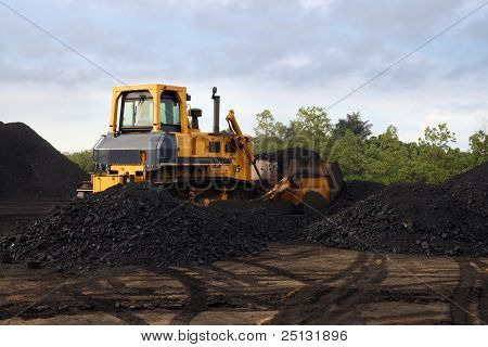 earthmover working in open mine pit