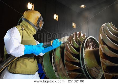 A worker working in a sandblast workshop
