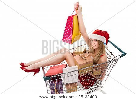 Christmas woman in santa hat sitting in shopping cart over white background