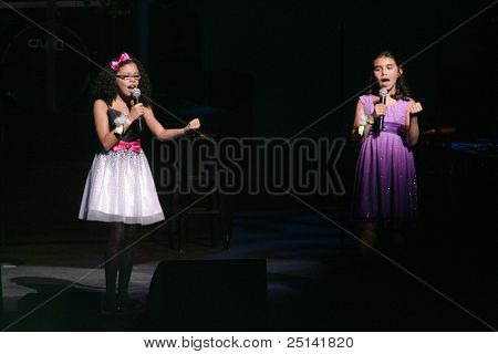 NEWARK - NOVEMBER 9: Singers Kayla Whiting (L) and Talia Maldonado perform at the 9th Annual Concert for Kids on behalf of the Boys and Girls Club of NJ at NJPac on November 9, 2011 in Newark, NJ.