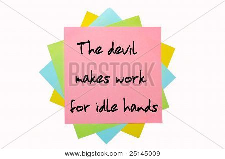 "Proverb "" The Devil Makes Work For Idle Hands "" Written On Bunch Of Sticky Notes"
