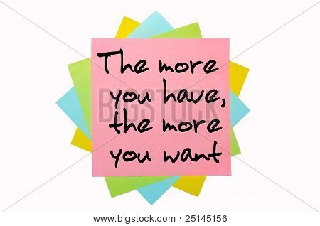 """Proverb """" The More You Have, The More You Want """" Written On Bunch Of Sticky Notes"""