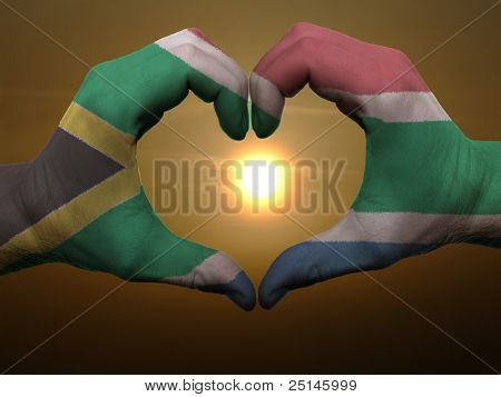 Heart And Love Gesture By Hands Colored In South Africa Flag During Beautiful Sunrise