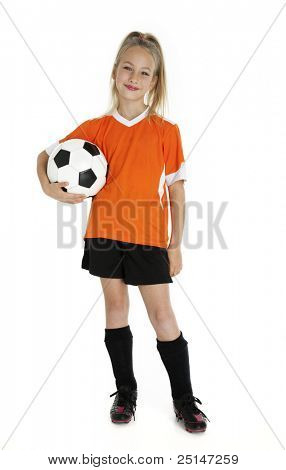 Nine year old girl holding soccer ball isolated on white.