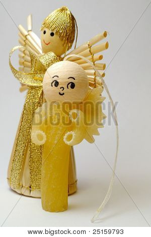 Two Christmas decorative figurines made of reeds and pastes
