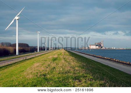 Wind turbines along a lake