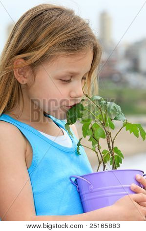 child with a plant