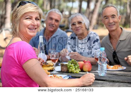 Mature friends eating alfresco