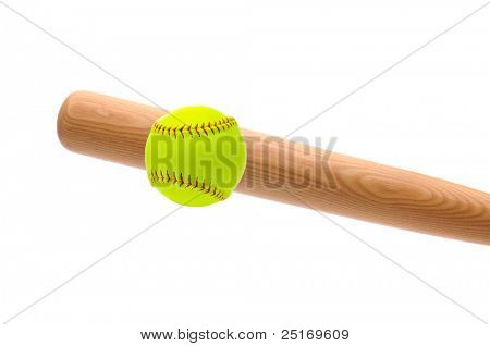 Wood bat hitting a yellow softball over a white background.