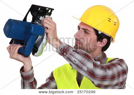 craftsman holding an electric cutter