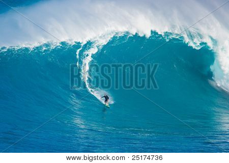 MAUI, HI - MARCH 13: Professional surfer Yuri Soledade catches a giant wave at the legendary big wave surf break known as