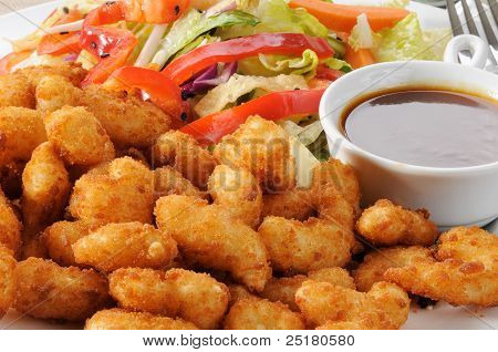 Breaded Shrimp And Salad Close Up