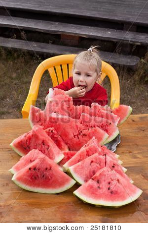 Little Child Eating Watermelon