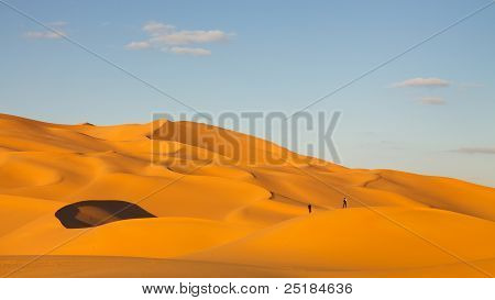 Tourists In The Sand Dunes Of The Sahara Desert