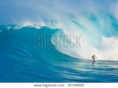 MAUI, HI - MARCH 13: Professional surfer Yuri Soledade rides a giant wave at the legendary big wave surf break known as