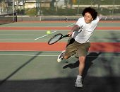image of teenage boys  - teenage boy playing tennis - JPG