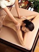 stock photo of spa massage  - Woman in a day spa getting a deep tissue massage - JPG