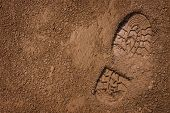 stock photo of footprints sand  - Imprint of the shoe on mud with copy space - JPG