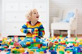 Child Playing With Toy Blocks. Toys For Kids. poster