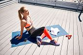 Top View Of Happy Sportswoman Having Good Time While Resting After Exercising With Weights. She Is S poster