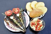 An Apetitic Fish With A Grill Served In A Plate With A Tomato And Onions, A Plate With A Cucumber Sa poster